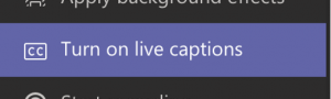 Teams interface. Turn on live captions option.