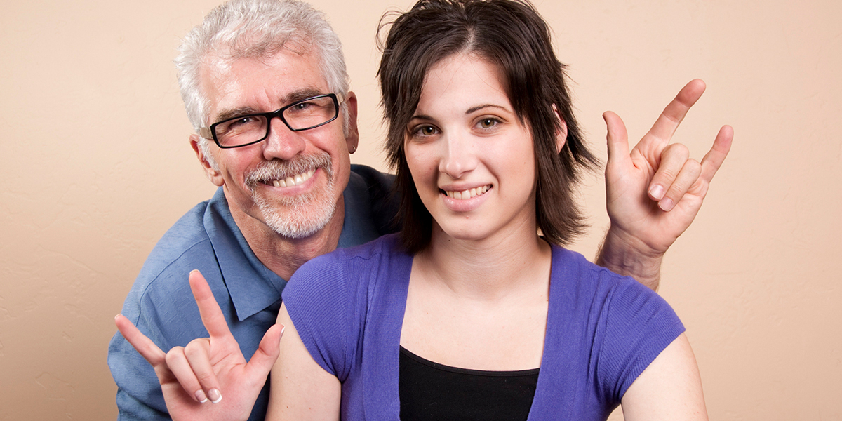 Two sign language interpreters looking forward