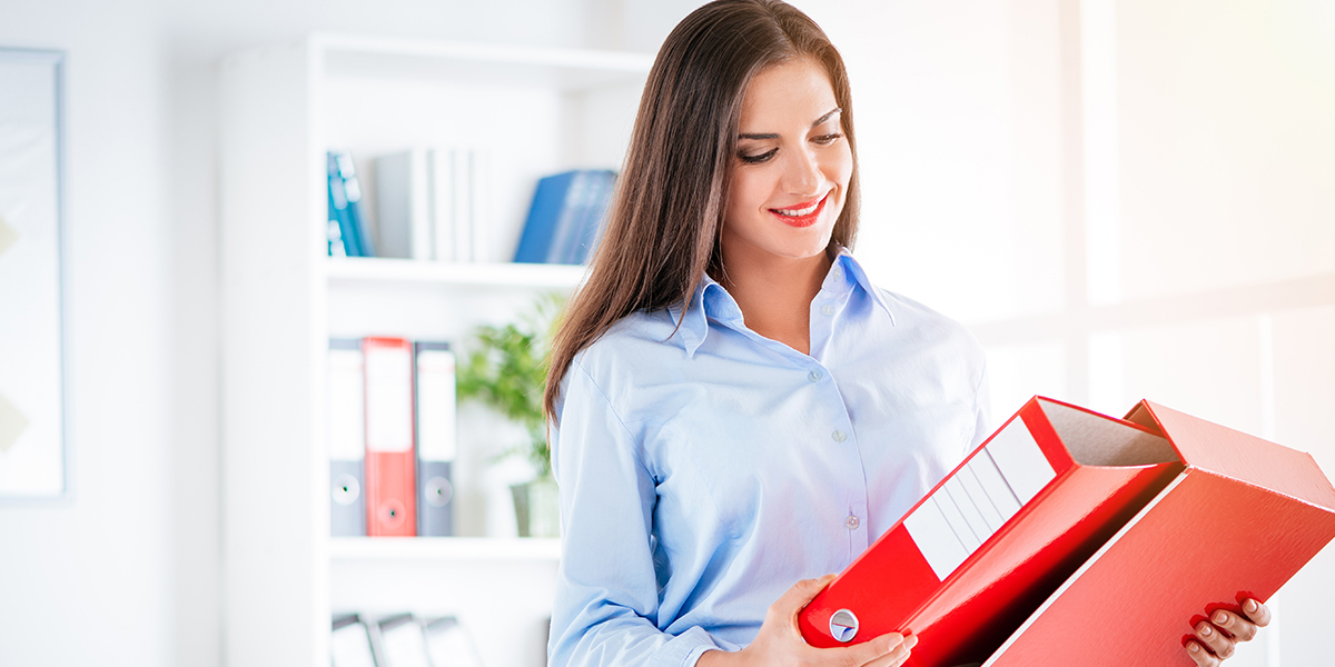 A legal professional reviewing a binder