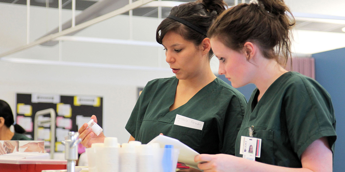 Two medical staff reviewing a prescription