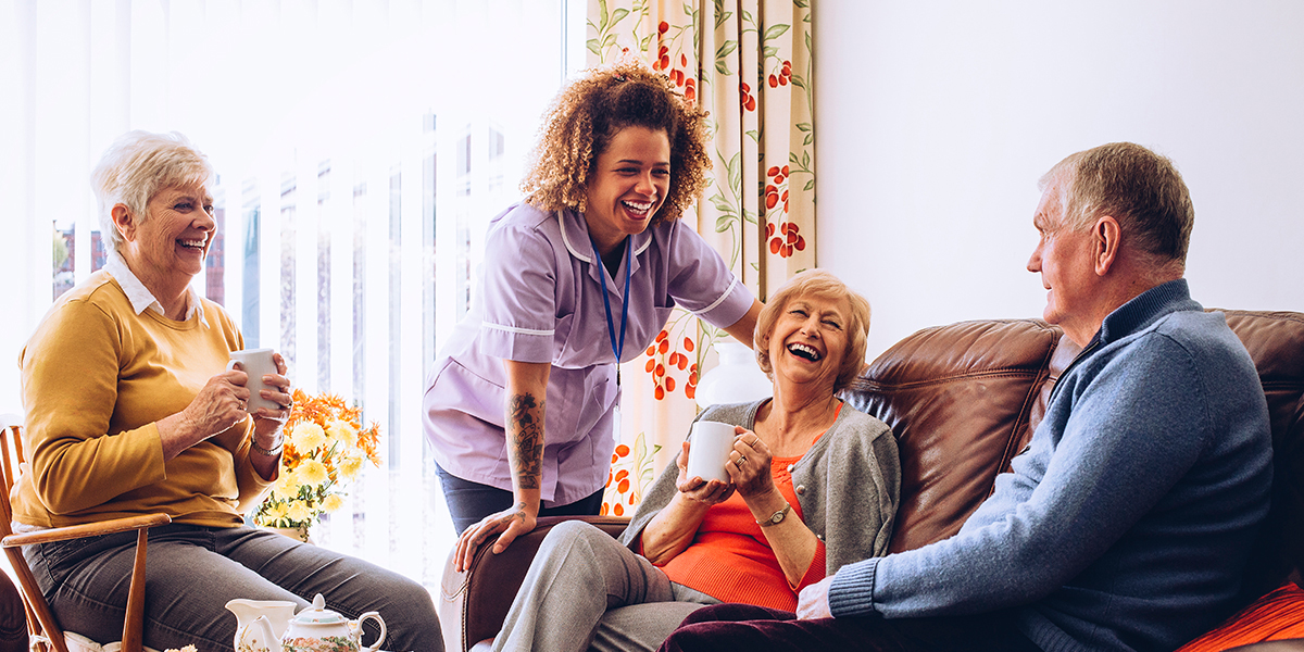 A caregiver chatting with seniors