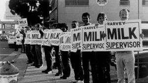 Line of people holding up Harvey Milk Supervisor signs