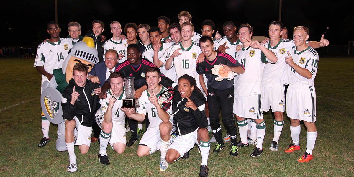 Durham College Men's soccer team smiling for a picture after the campus cup game