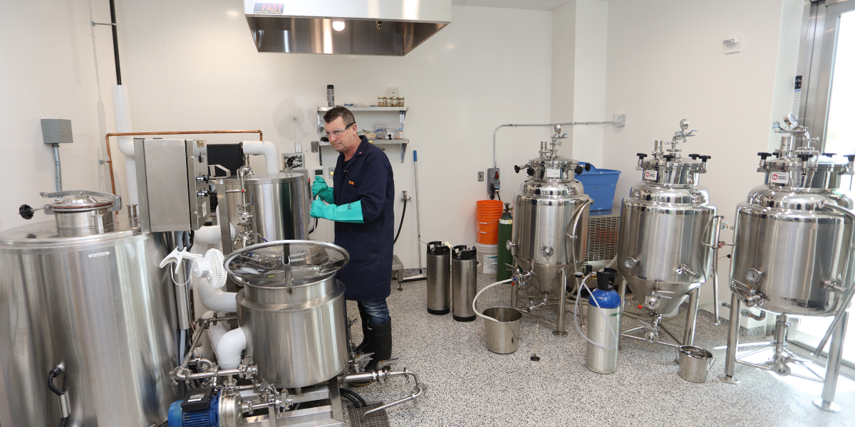 Student using brewery equipment at DC's brew lab
