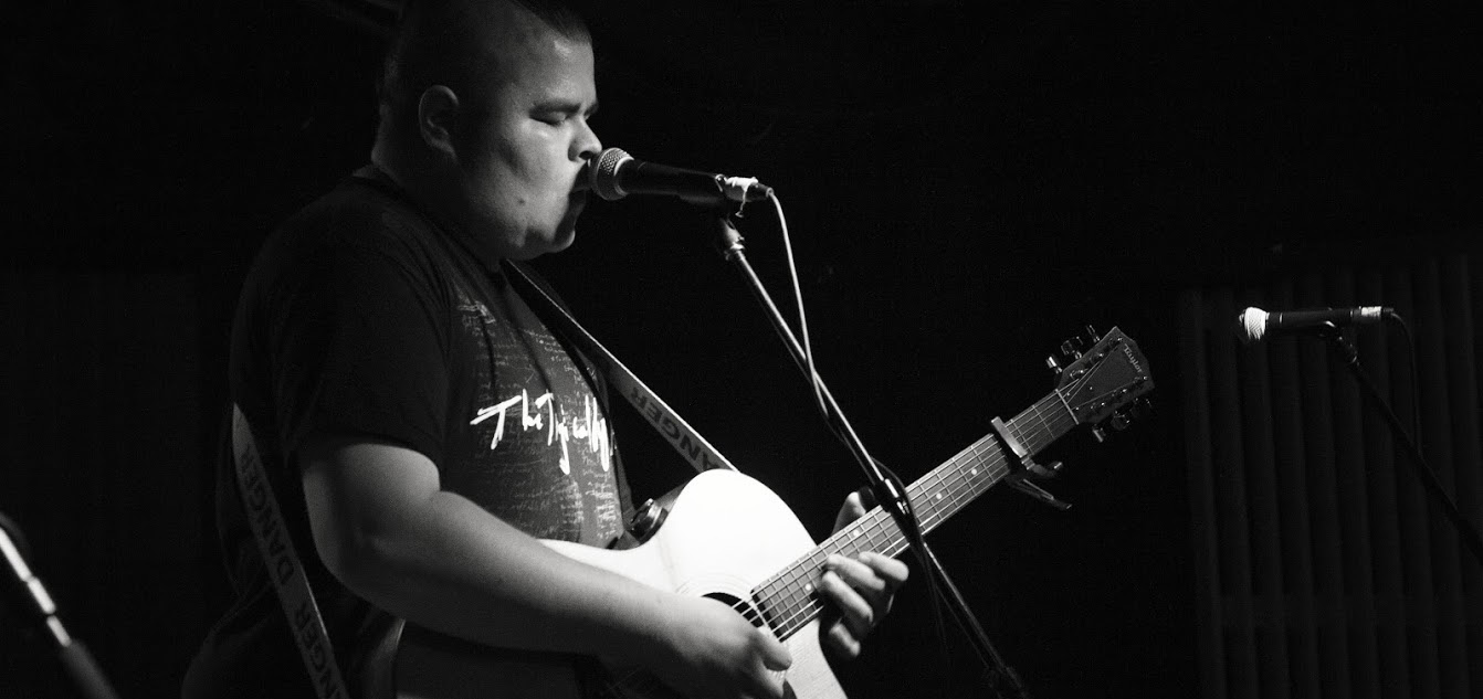 Music Business Management student Cale Crowe performs on stage