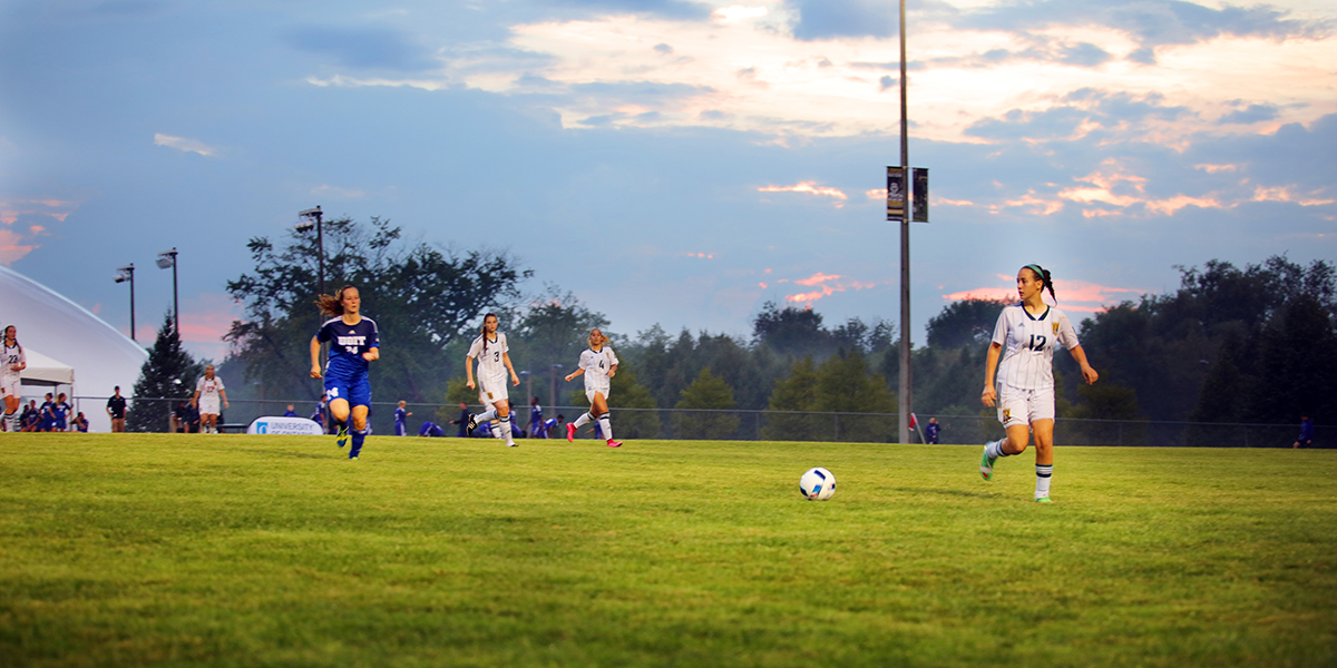 Durham Colleges Women soccer team race for the ball against the UOIT Ridgebacks during the campus cup games