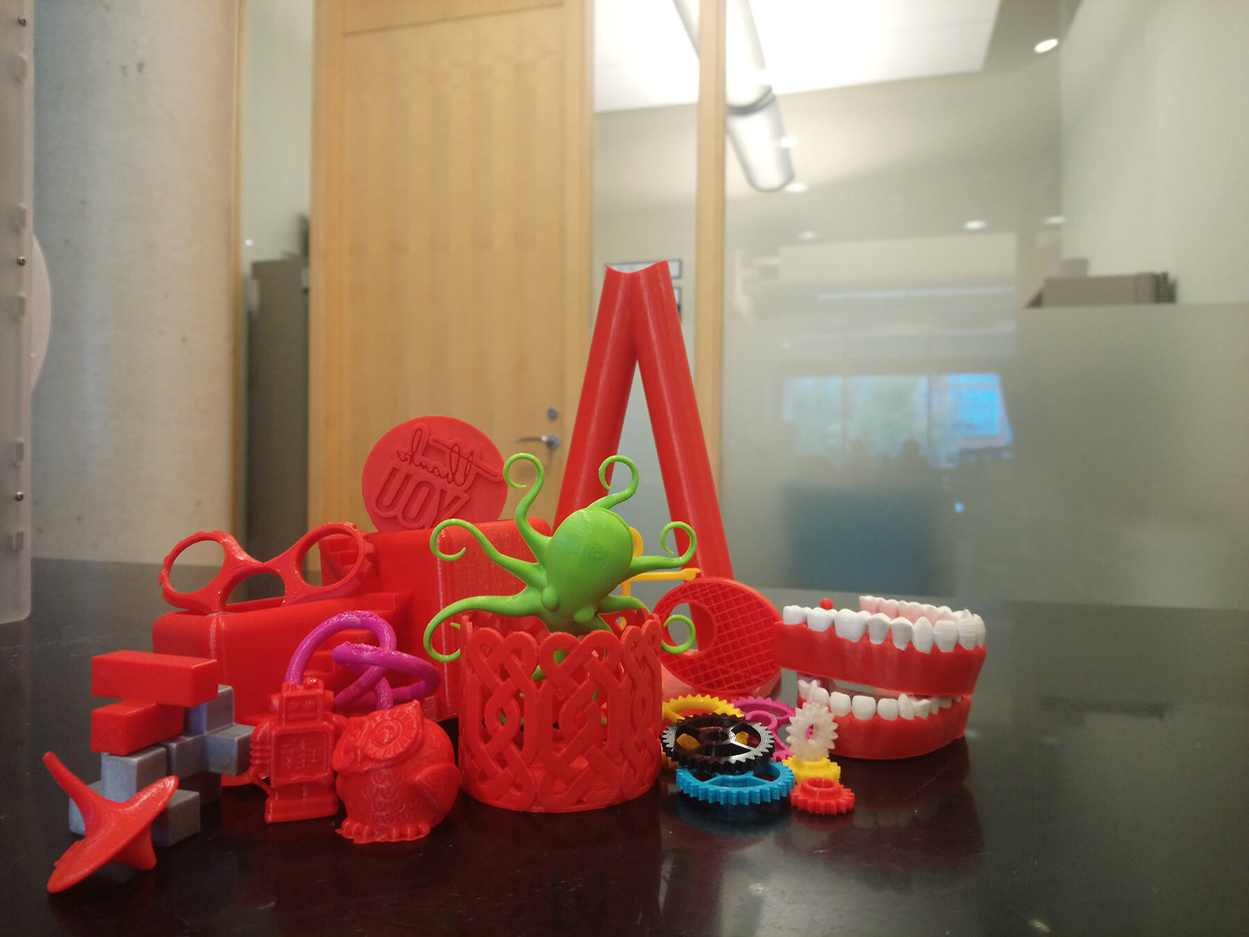 A variety of 3D printed items in various colours