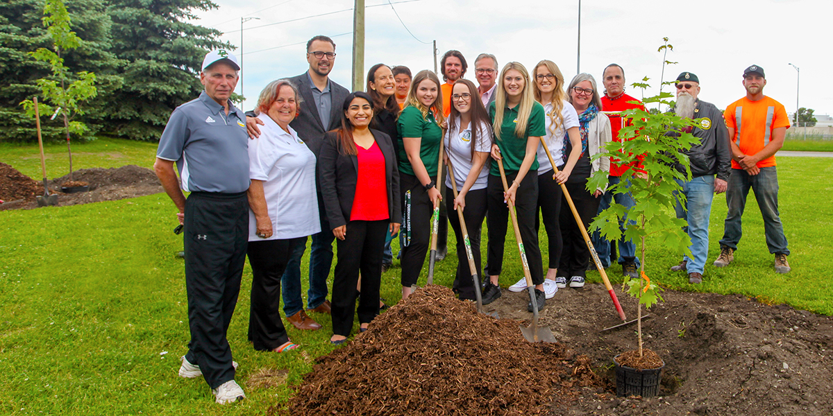 DC employees and students participate in the Highway of Heroes Tree Campaign planting ceremony
