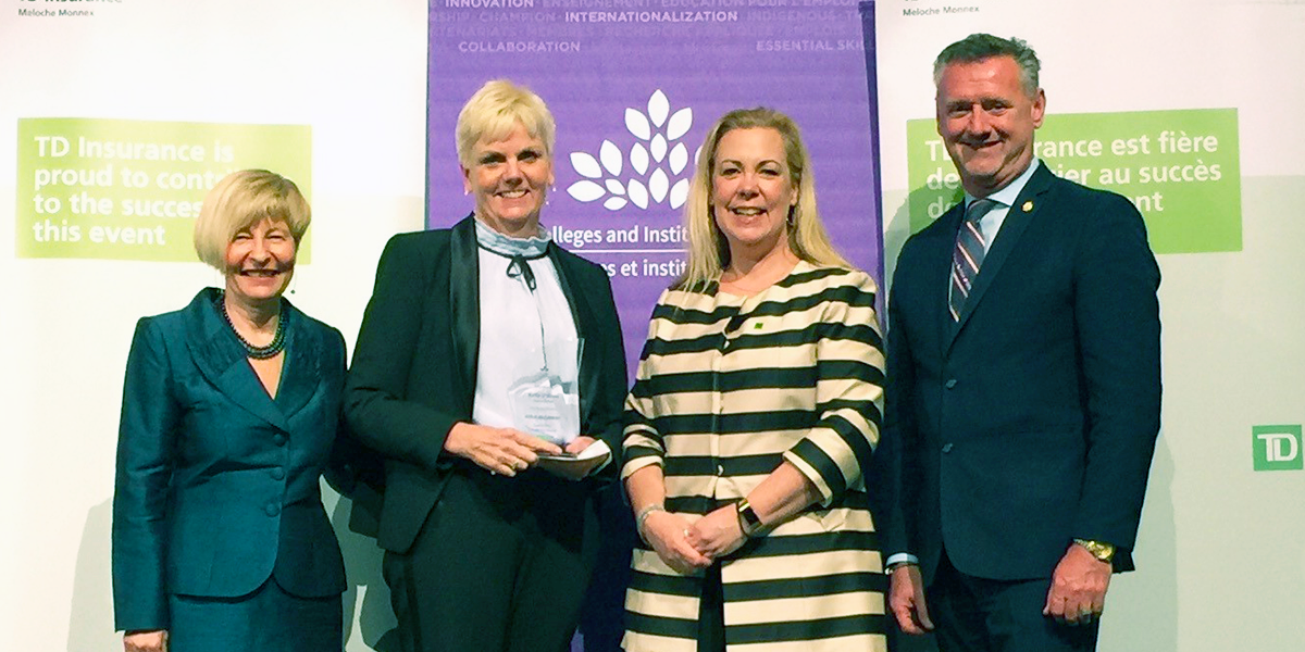 Kelly O'Brien receiving an award