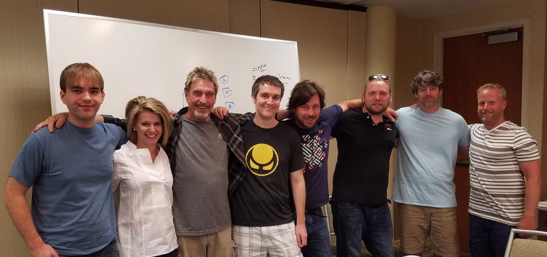 DC grads with team and John McAfee