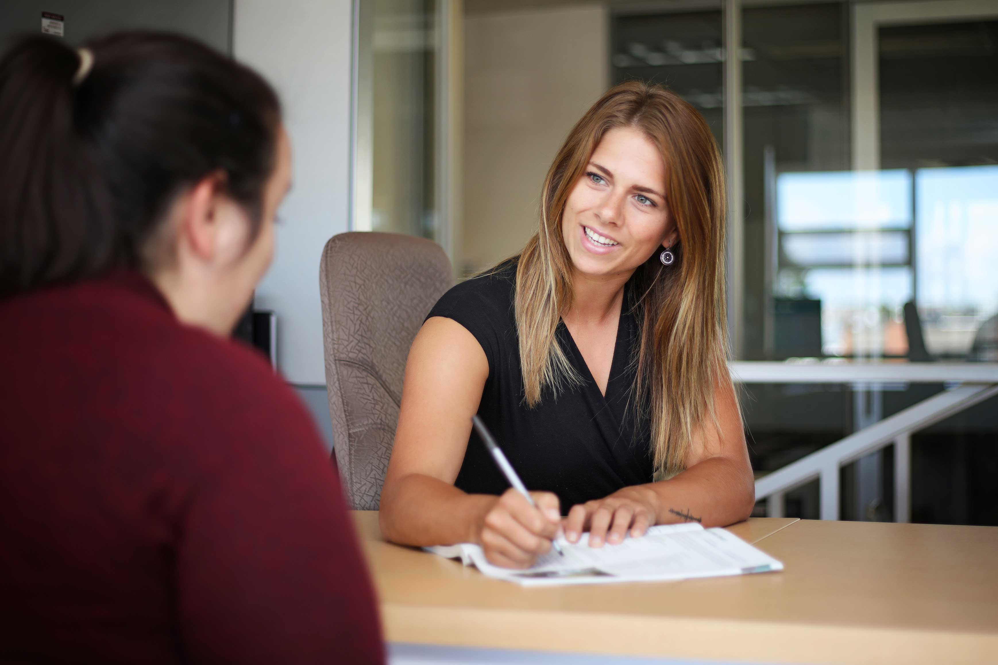 Woman at admissions desk