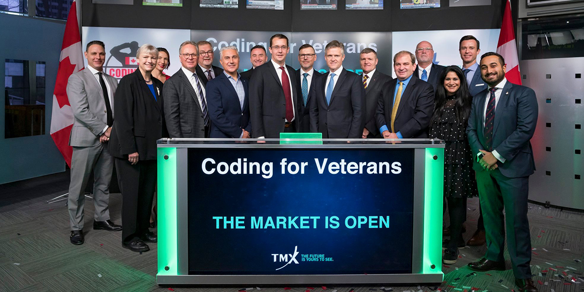 Group of people including president Don Lovisa opening the TSX