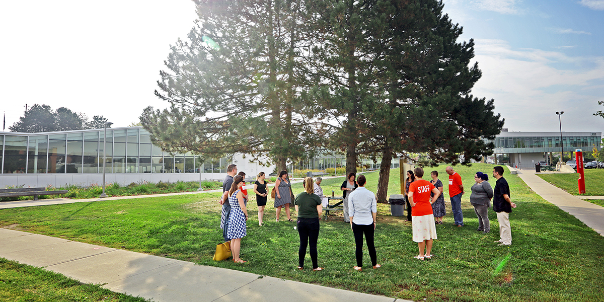 Students and faculty outside participating in an aboriginal prayer