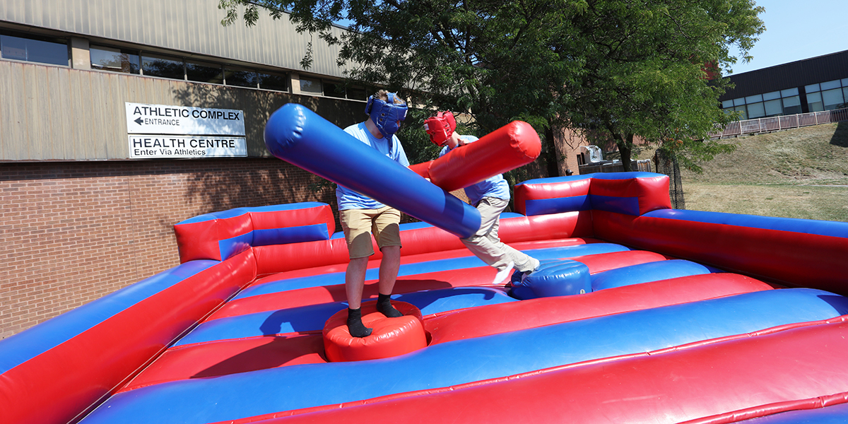 students sparing at the first year fun fair