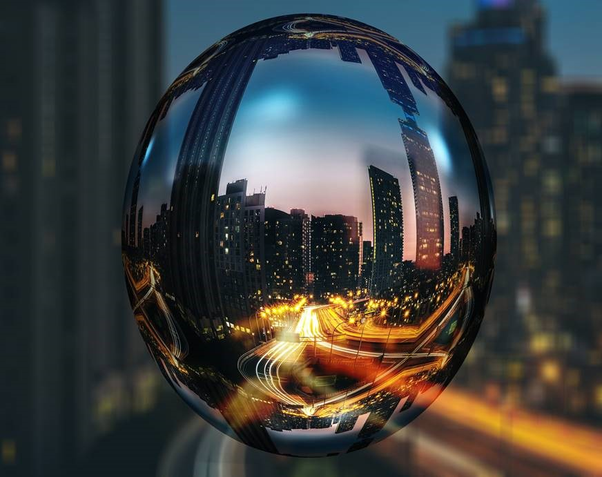 Reflection of buildings as seen from a silver sphere
