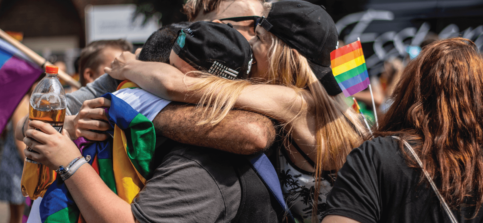 image of people hugging at pride parade