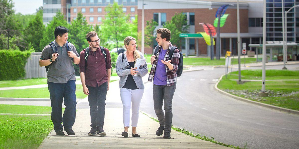 Students at the DC Oshawa campus bus loop.
