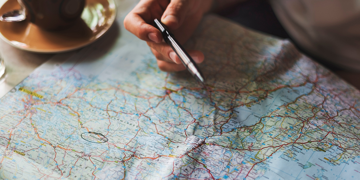 Picture of a person looking at a map