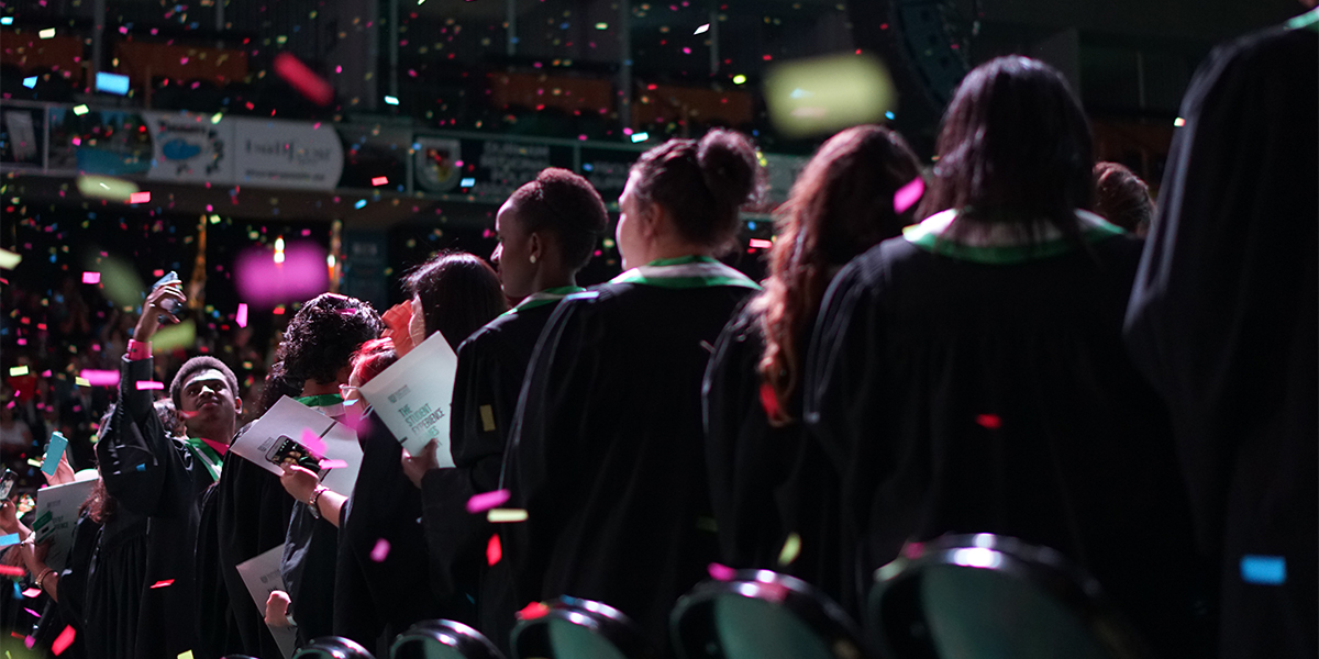 Students celebrate on day 3 of convocation, with confetti in the air