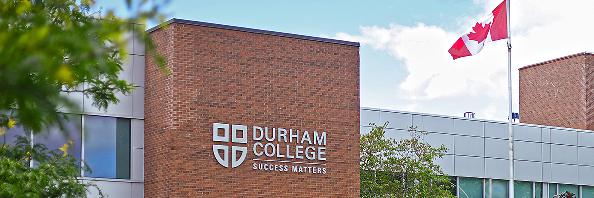 DC logo in view on the Gordon Willey building at Durham College.