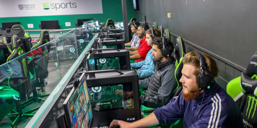 Participants of the Esports summer camp playing PC games at the Esports arena